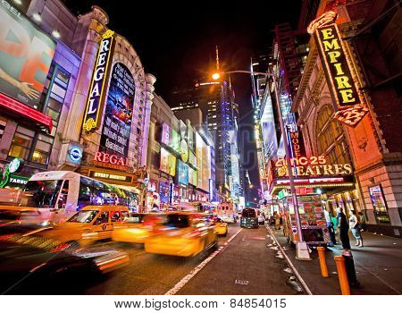 NEW YORK, USA - JUNE 28th 2014: Times Square and 42nd Street is a busy tourist intersection of neon art and commerce and is an iconic street of New York and America