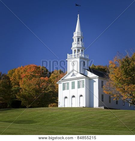 Traditional American white church in the fall
