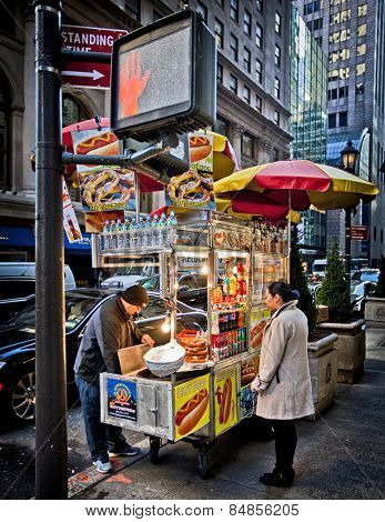 NEW YORK, USA - NOVEMBER 13th, 2014: Food cart vendors can be found all over the streets of midtown Manhattan providing hot dogs and snacks