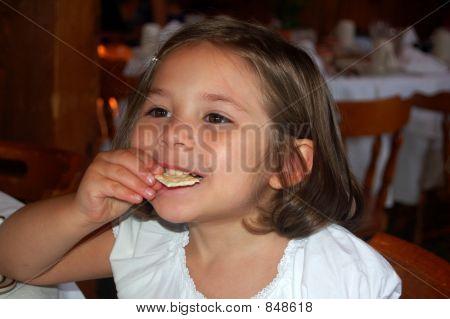 Girl eating cracker