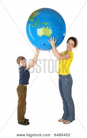 Mother And Son Holding Big Inflatable Globe And Looking At Camera, Side View, Isolated