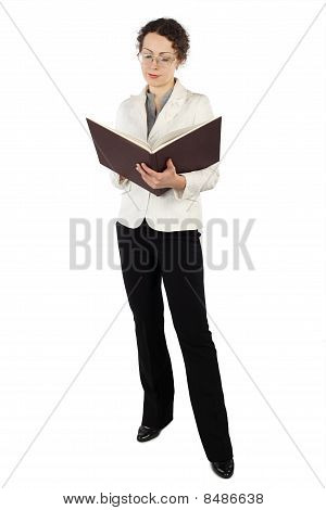 Young Attractive Woman In Business Dress Standing And Reading Big Book Isolated On White