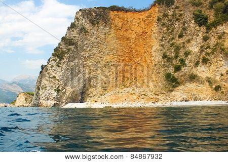 The rocks over the transparent ocean water. Montenegro. Rafailovici poster