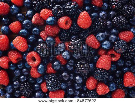 blueberries, raspberries and black berries shot top down