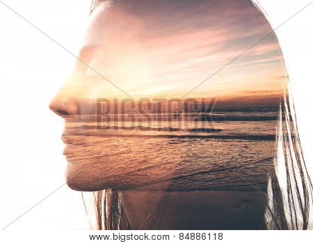 Double exposure portrait of a woman combined with photograph of nature