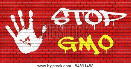 no gmo stop genetic manipulated organisms or food engineering graffiti on red brick wall, text and hand