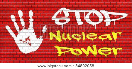 no nuclear power stop radiactivity radio active waste from nuclear power plant danger of radiation and risk of contamination by gamma radiation graffiti on red brick wall, text and hand