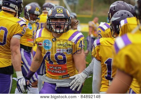 VIENNA, AUSTRIA - MARCH 23, 2014: LB Simon Blach (#49 Vikings) is welcomed by his teammates before an AFL football game.
