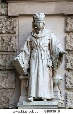 VIENNA, AUSTRIA - OCTOBER 10: Edmund Hofmann von Aspernburg: Magister, on the facade of the Neuen Burg on Heldenplatz in Vienna, Austria on October 10, 2014.