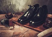 Shoe care accessories on a wooden table  poster