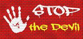 stop the devil no evil or sinning graffiti on red brick wall, text and hand poster