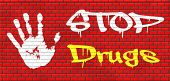 stop drug addiction no drugs addict cocaine heroin crack christal meth graffiti on red brick wall, text and hand poster