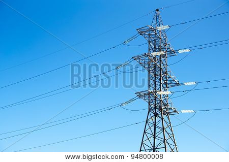 High Voltage Power Lines Against The Blue Sky