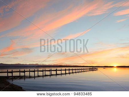 Lake Starnberg And Mountain Range At Sunset