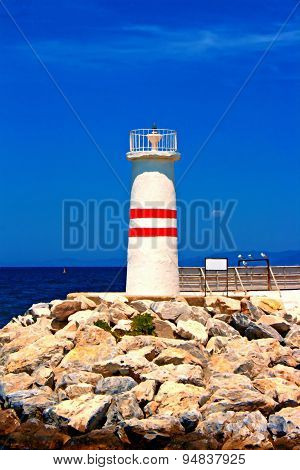 A Digital Painting Of A Lighthouse At The Entrance To Kusadasi Harbor Turkey