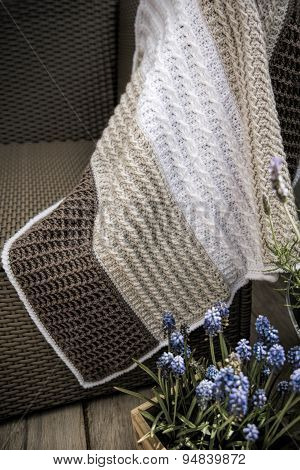 Crochet, Cable Knit Baby Blanket in Cream White and Brown Color on Sofa