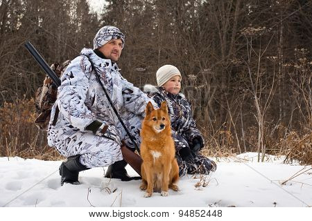 The Hunter With His Son And Their Dog
