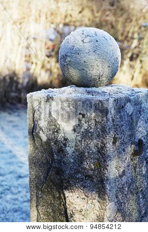 Granite Ball On A Pedestal Covered With Frost