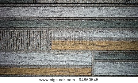 Old Wall Made Of Colored Resin Stone Slabs, Close Up