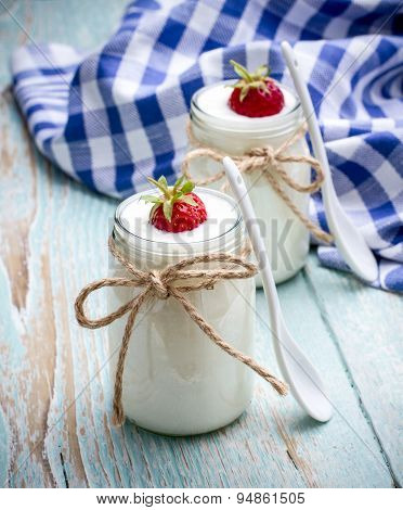 Two Glass Yogurt With Strawberries On Wooden