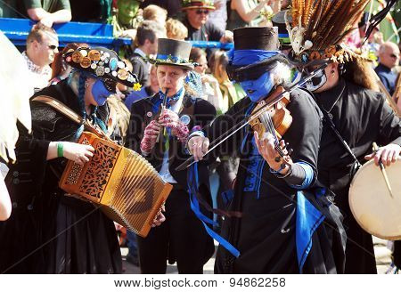People play music in a carnival
