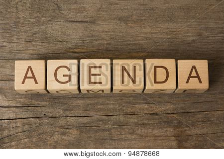 AGENDA text on a wooden cubes on a wooden background poster