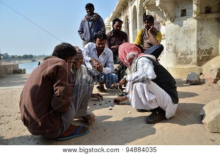 Jodhpur, India - January 1, 2015: Indian Men Play Traditional Street Game In Jodhpur