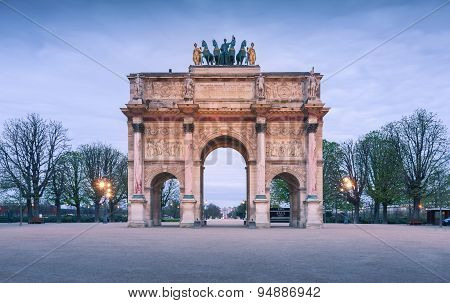 The Arc de Triomphe du Carrousel as the main entrance to the Louvre Museum.
