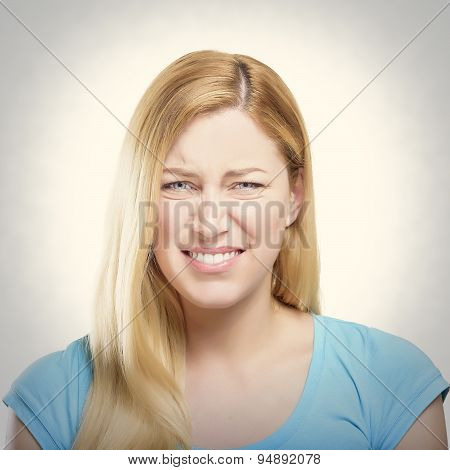 Blonde Woman Grimacing.