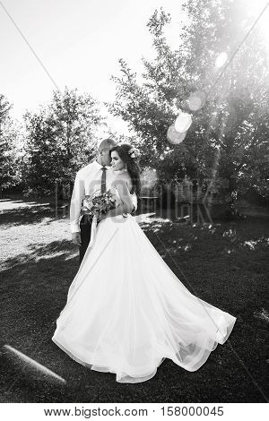 Monochrome closeup portrait bride and groom Outdoors. Joyous. Wedding day