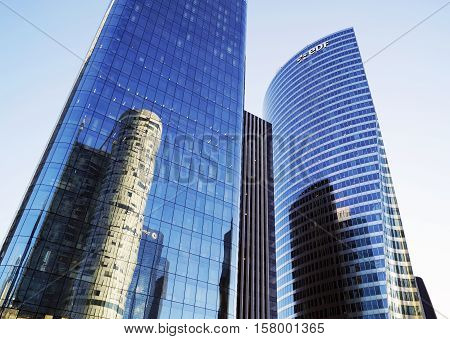 PARIS FRANCE - SEPTEMBER 29 2015: EDF and OPUS 12 skyscrapers in La Defense business district in Paris France