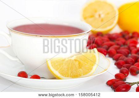 Dog rose, Rose hips red tea with lemon.Rosa canina hips.