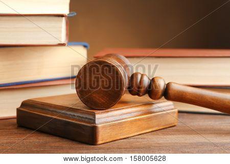 Judge's gavel and books, closeup
