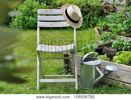 hat on a chair in a garden