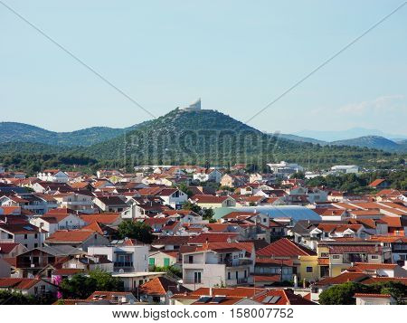 Cityscape Vodice on the background hill church Okit Our Lady of Carmel.