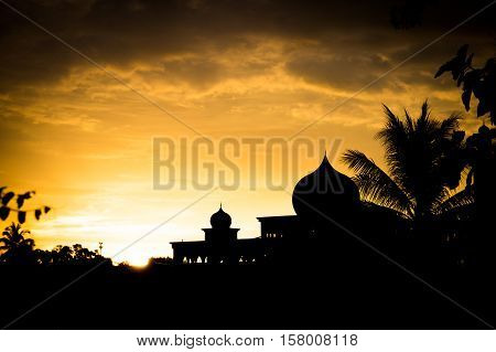 Silhouette of Mosque in Langawi, Malaysia at sunset. Islam is the state religion of Malaysia