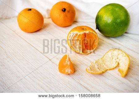 tangerine and lime on white boards closeup
