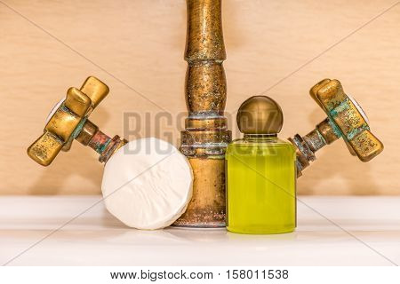 Vintage faucet, soap and shower gel arrangement