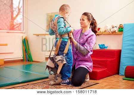 Cute Kid Is Going To Have Physical Musculoskeletal Therapy In Rehabilitation Center