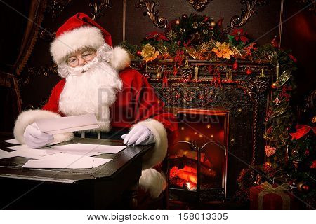 Santa Claus is preparing for Christmas, he is reading children's letters. Mail of Santa Claus. Christmas decoration.