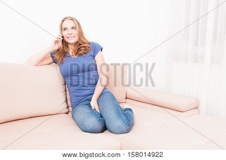 Lady Sitting On Couch Talking At Phone