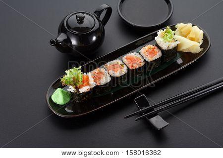 Salmon Hoso Maki On A Black Plate