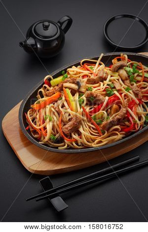 Asia Food. Udon Noodles With Pork On The Black Table.