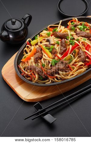 Asia Food. Udon Noodles With Veal On The Black Table.