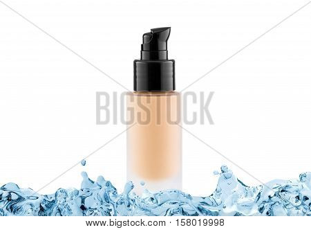 Foundation cosmetic glass tube with copy space in water splash tone cream moisturiser concept isolated on white