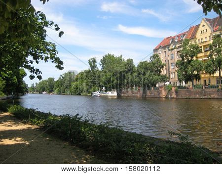 photos from the summer landscape of the waterfront of the river Spree in Berlin (Germany) for use in design and printing