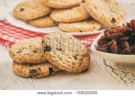 Wholewheat biscuits with raisins on white rustic table