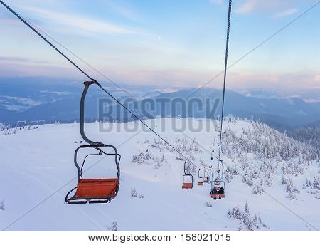 Winter Mountains Panorama With Ski Lifts