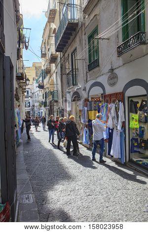 AMALFI TOWN SOUTH ITALY - NOVEMBER 5 : toursit walking in narrow street in amalfi town important traveling destination of mediterranean coast line on november 5 2016 in amalfi town south italy