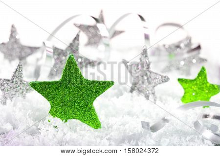 christmas background with stars and christmas decoration in the snow